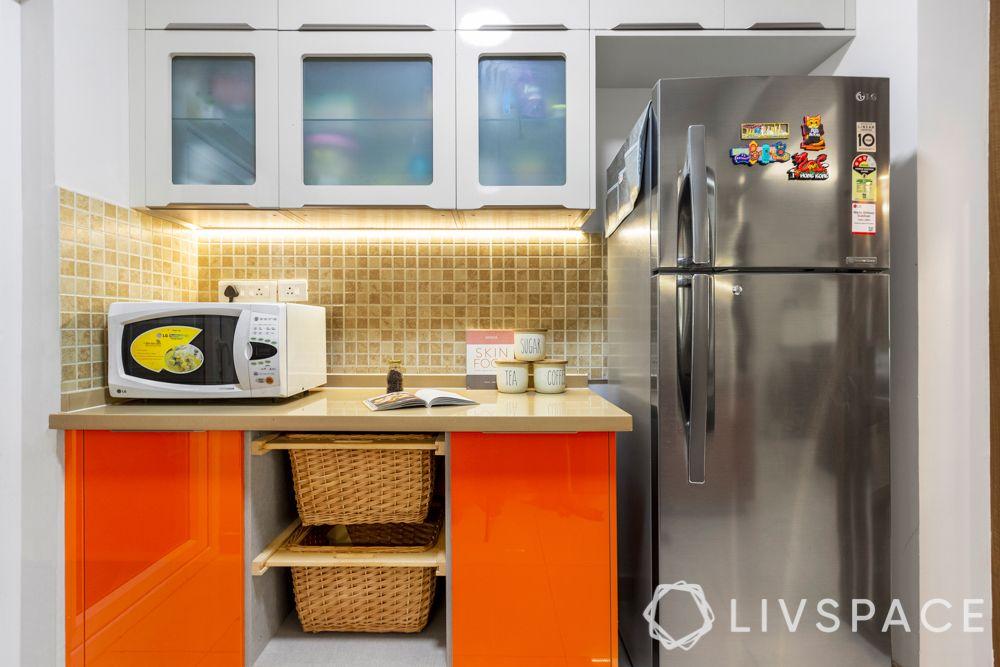 3 bhk home design-orange membrane kitchen-microwave-fridge