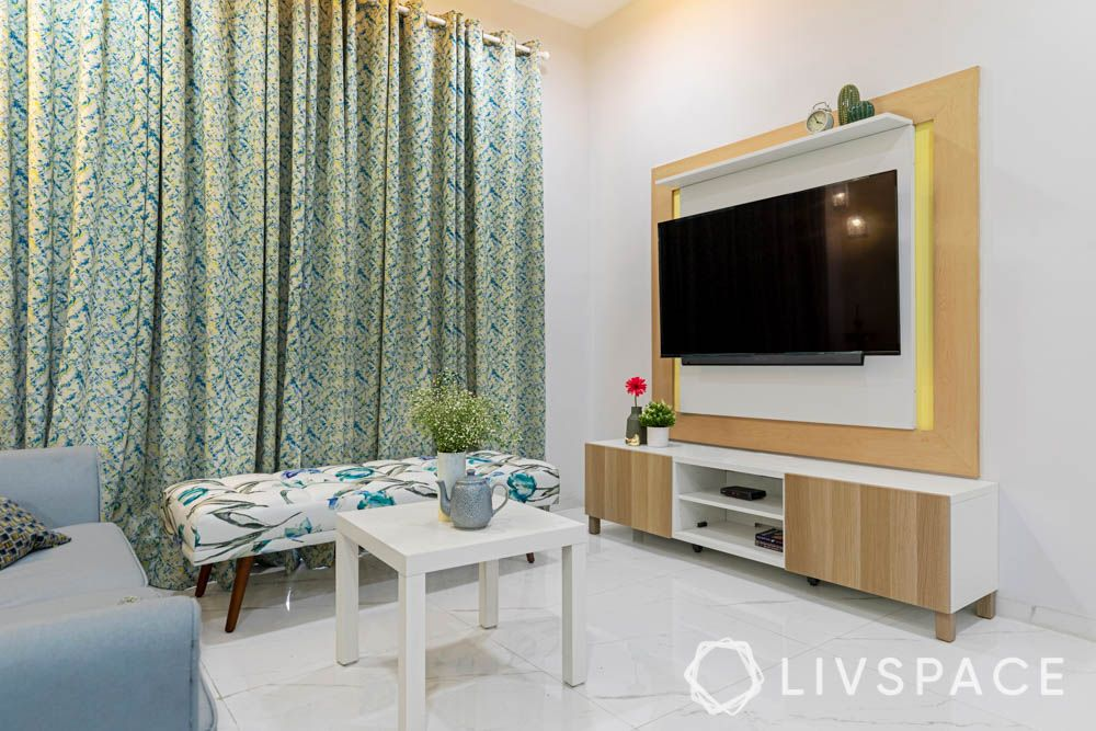 2bhk in hyderabad-yellow walls-wall trim designs-living room designs-floral bench-pendant ligh