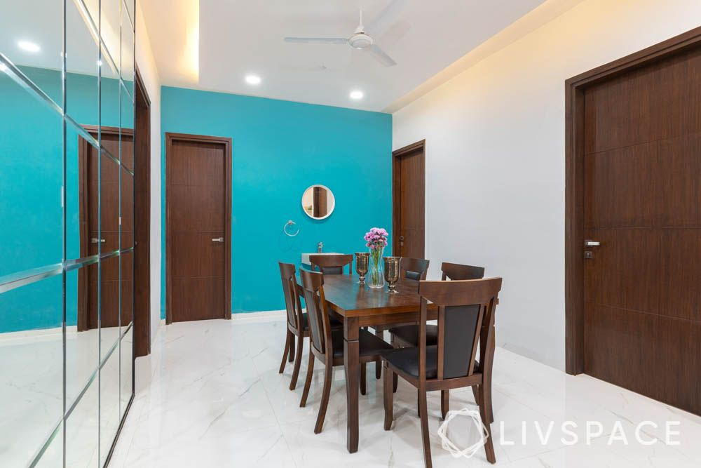 2bhk in hyderabad-mirror wall-blue feature wall-dining room designs
