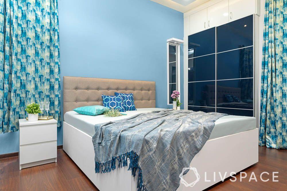 2bhk in hyderabad-master bedroom designs-blue wardrobe-white bed-vanity unit