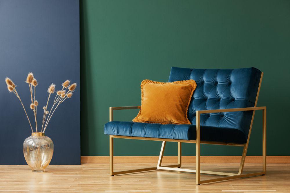 blue armchair-green wall