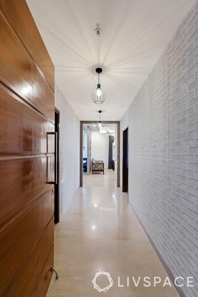 3BHK room design-exposed brick wallpaper-industrial pendant light