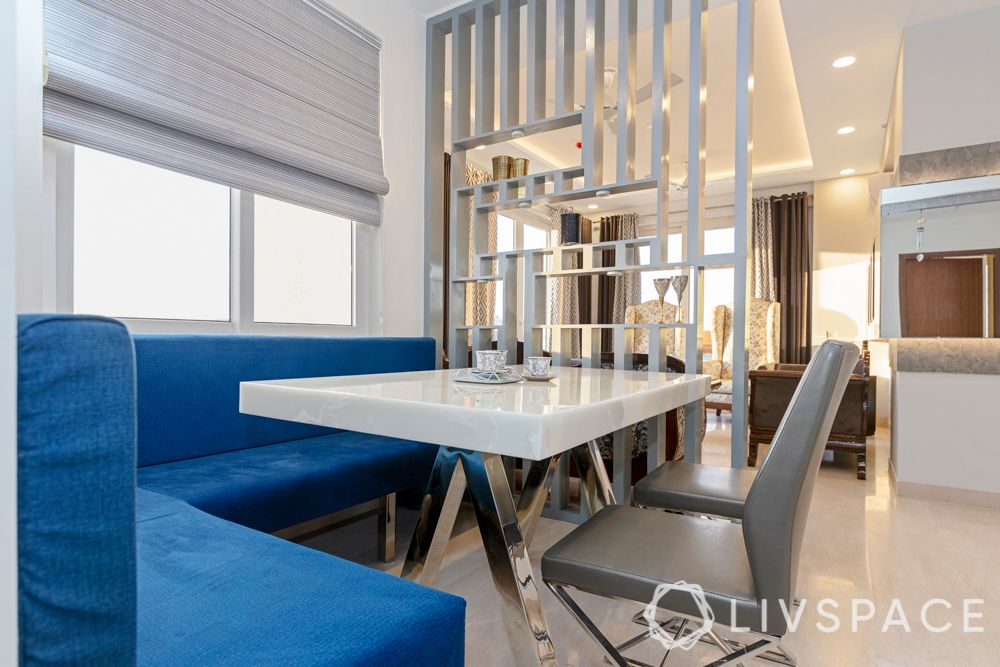 3BHK Room Design-dining room-grey chairs-grey partition-blue velvet bench