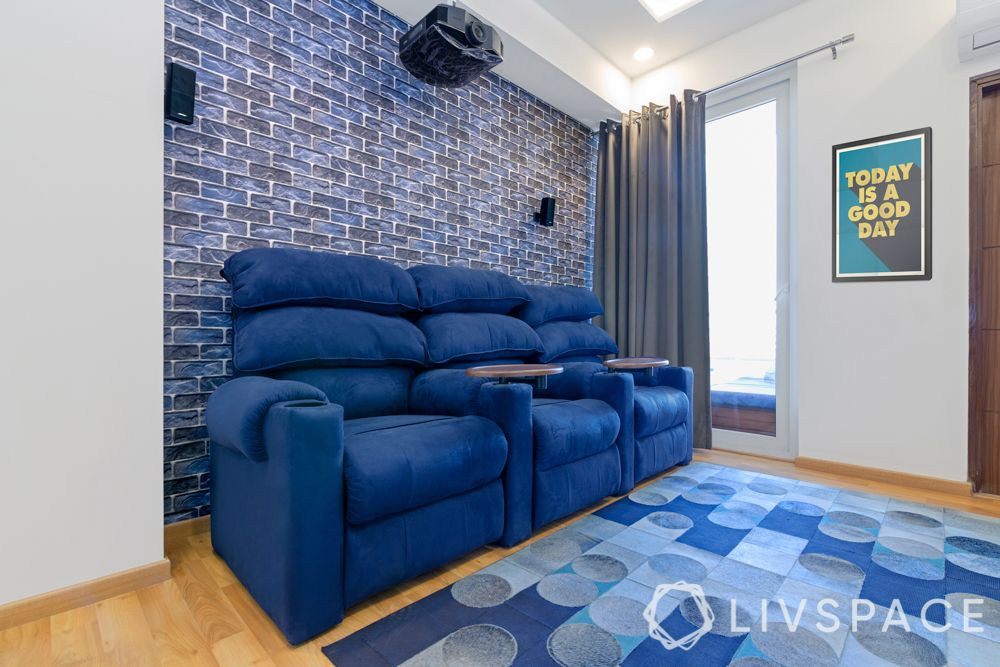 blue recliners-blue exposed brick wall