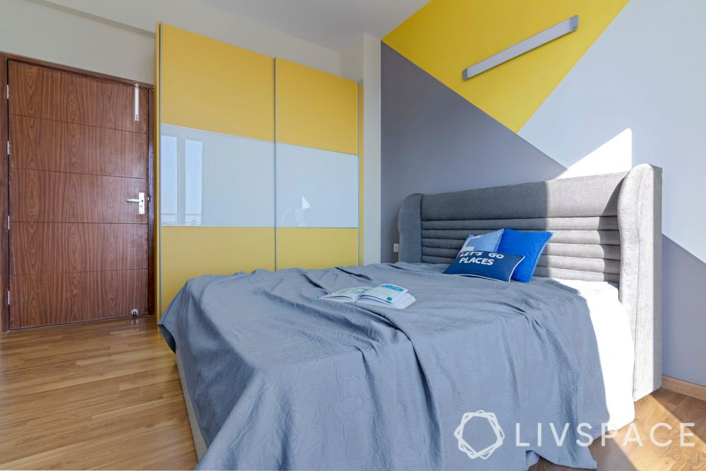 kids bedroom-grey bed-yellow wardrobe