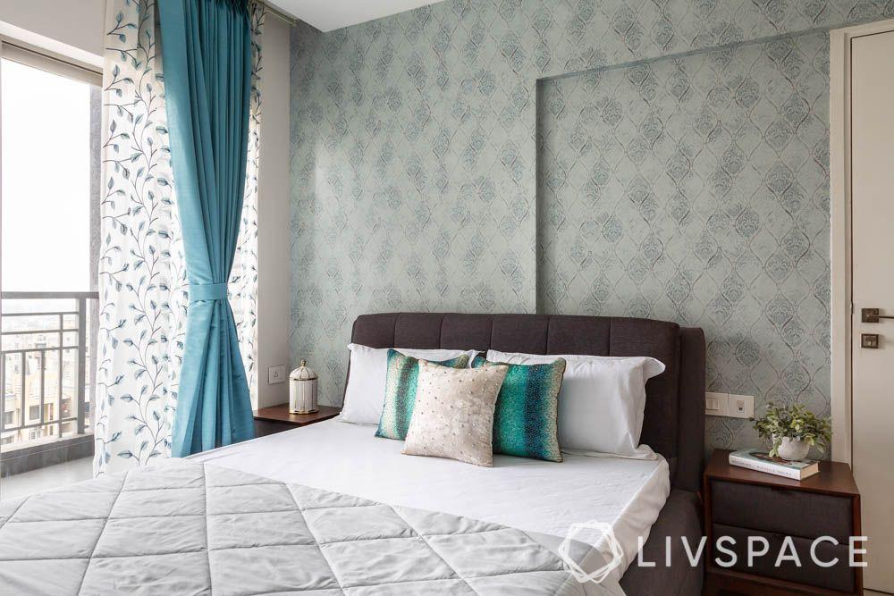 grey wallpaper-brown headboard