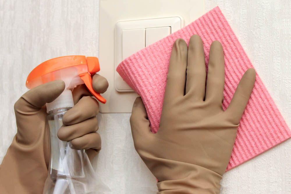 corona-safety-measures-cleaning-gloves-switches
