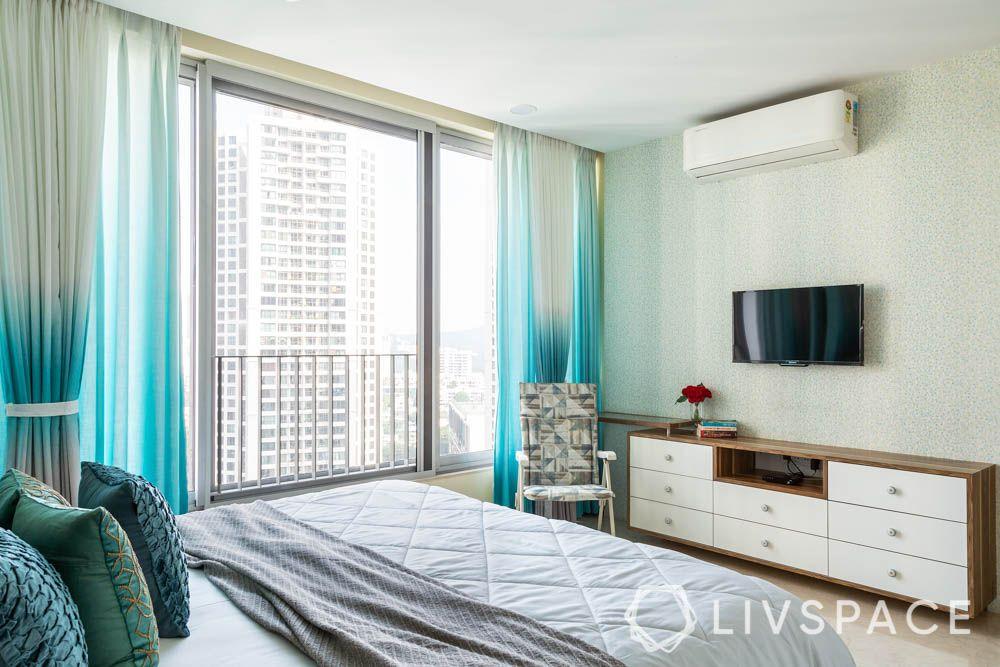 3bhk-house-design-parents-bedroom-laminate-tv-unit