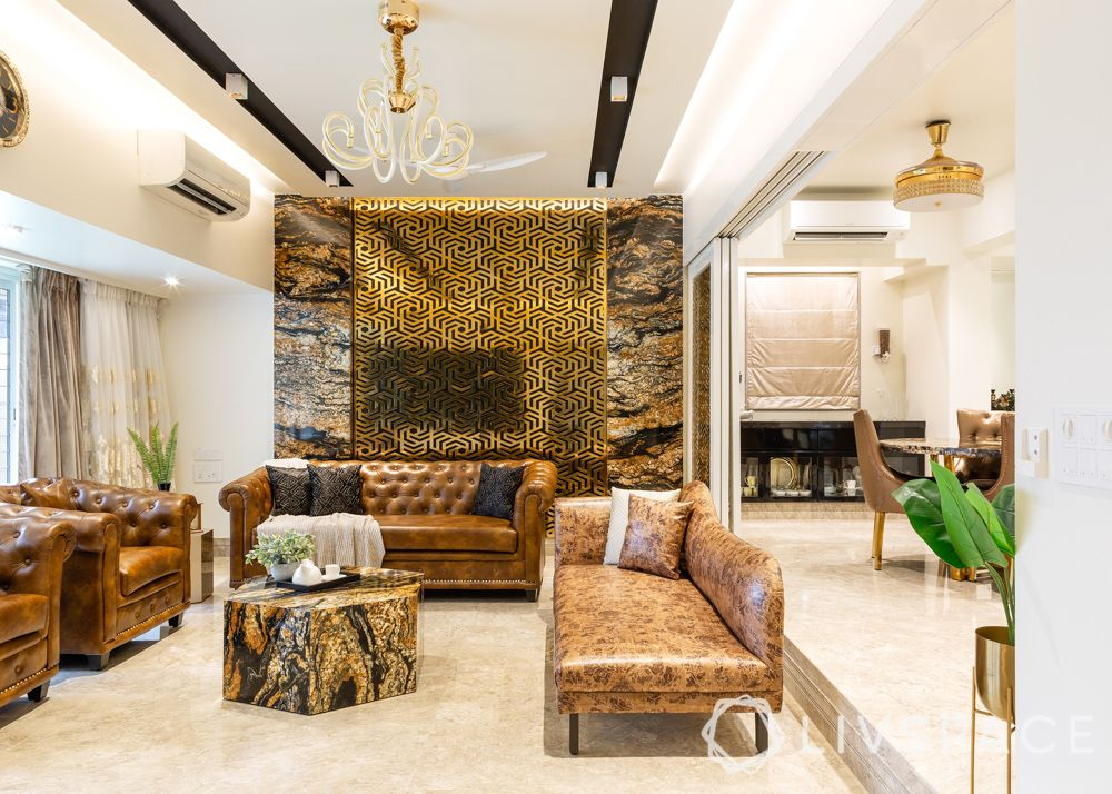 modern villa design-living room-brown leather sofa-black tv unit-stainless steel wall-gold wall-marble wall