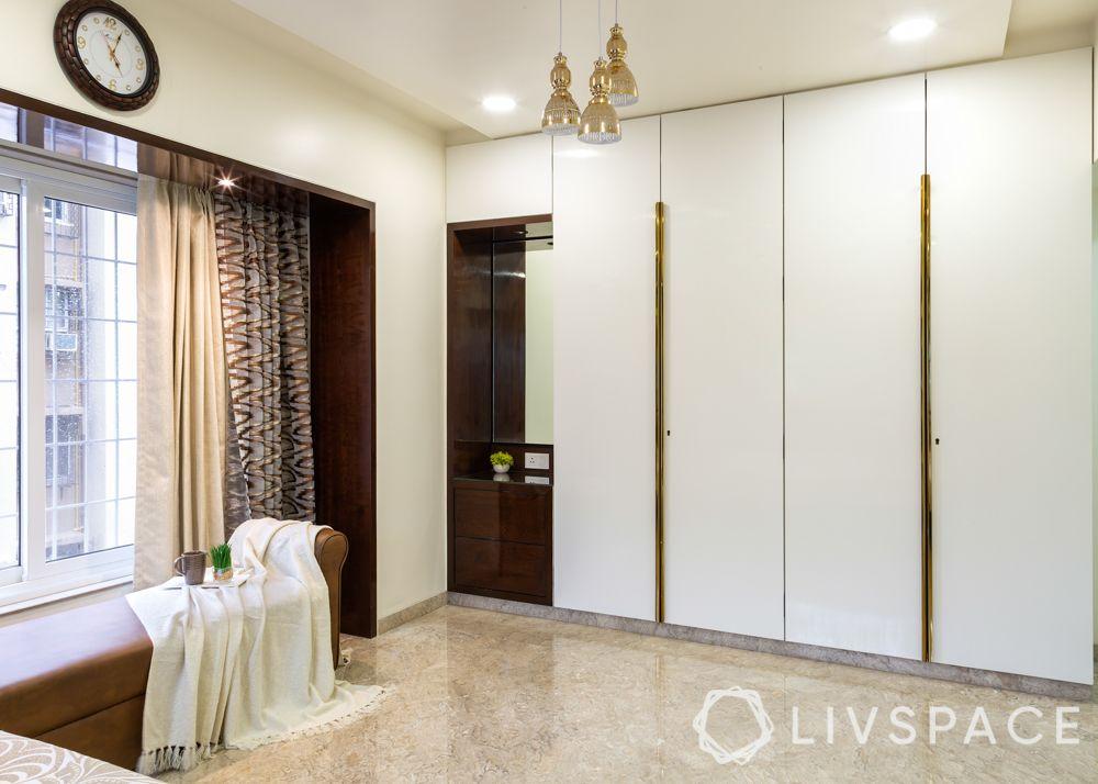 modern villa design-guest bedroom-brown sofa design-white PU finish wardrobes