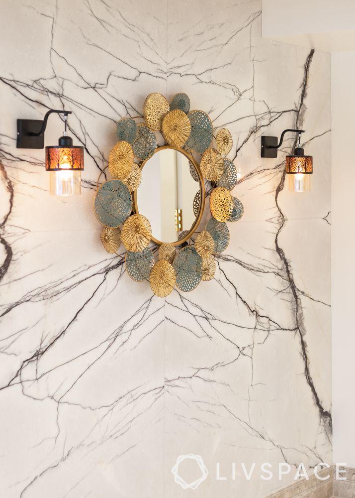 modern villa design-living room-blue sofa-floral armchairs-chandelier-marble tv unit-foyer