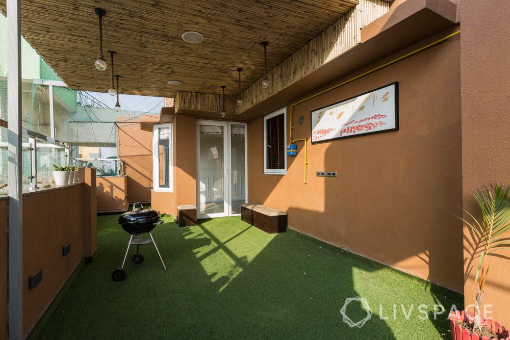 home balcony design-bamboo roof-turf-seating