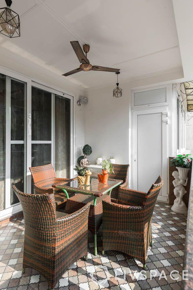 home balcony design-dining table set-wicker furniture-fan-lights