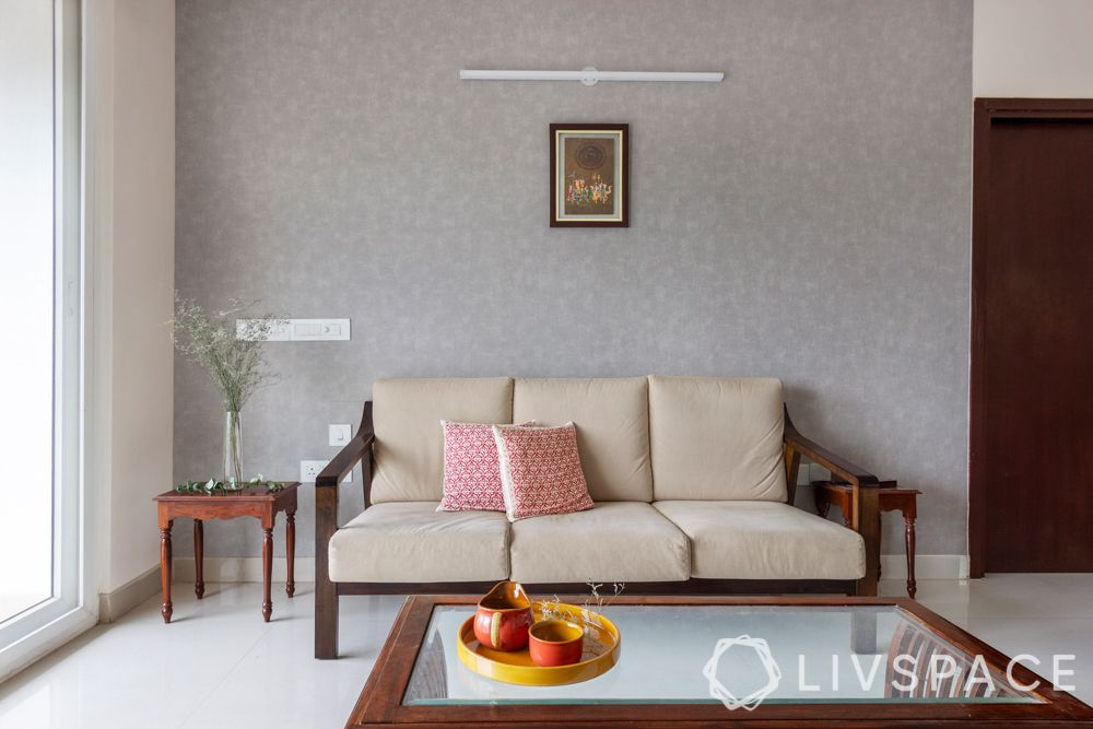 simple interior design-wooden sofa-brass lamps-wooden tv unit-coffee table-grey wallpaper