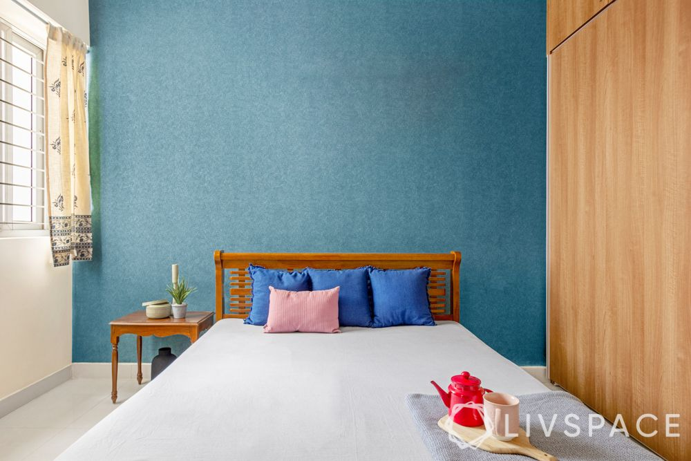 simple interior design-blue wallpaper-wooden wardrobe-wooden bed-side table
