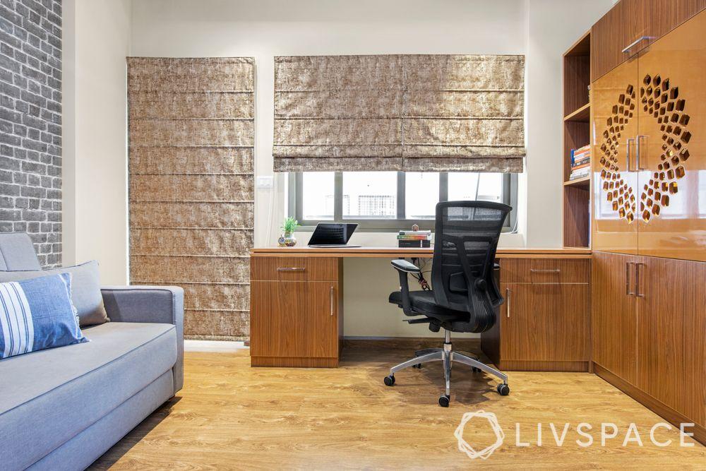 home office ideas-study room-pooja unit-jaali door-blue sofa-desk designs