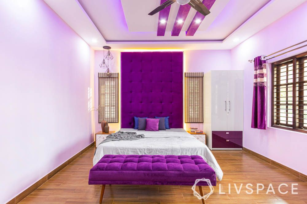top 10 interior designers in bangalore-fabric headboard-white bed-purple bench-acrylic wardrobe
