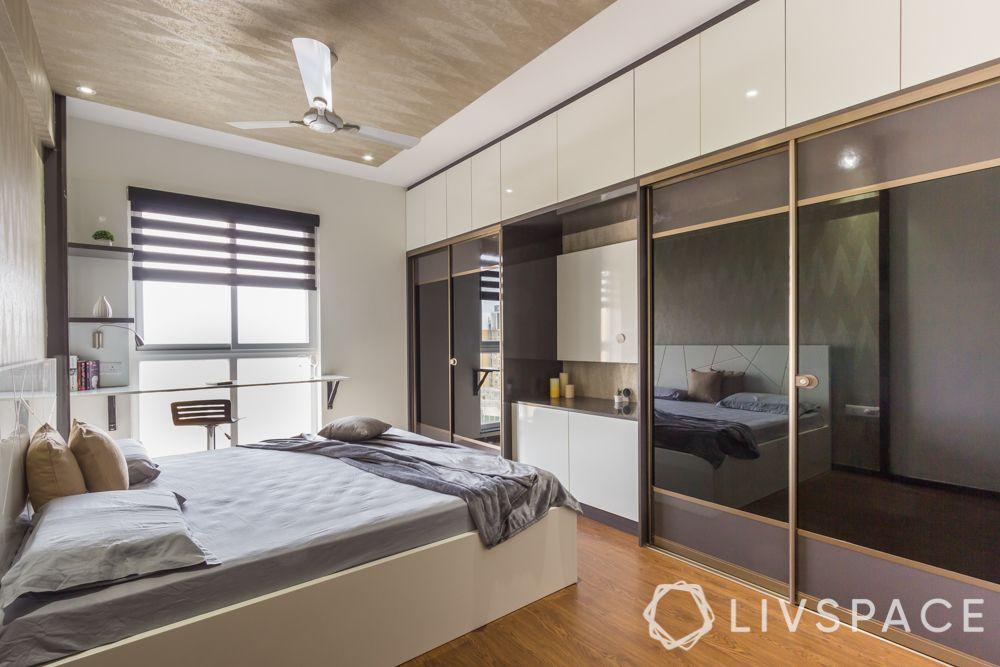 master bedroom design-lacquered glass wardrobe-black sliding wardobe