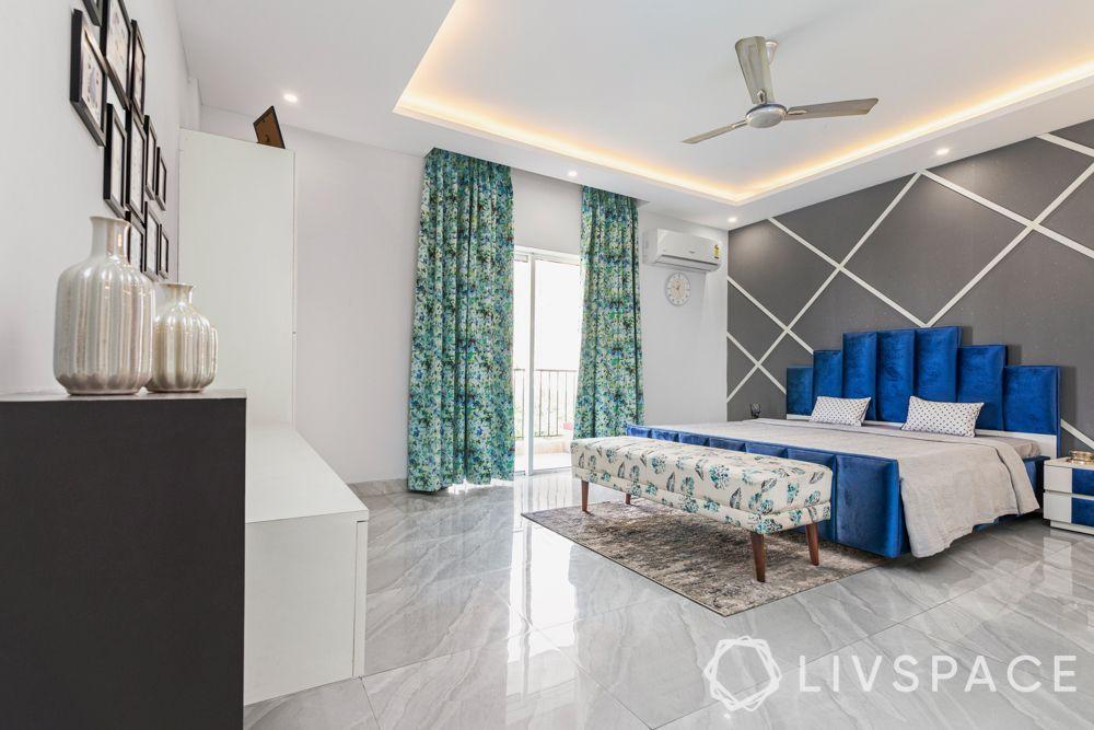 master bedroom design-blue headboard-grey wallpaper-flooring