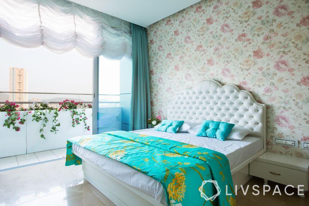 master bedroom design-white headboard-balcony designs-floral wallpaper