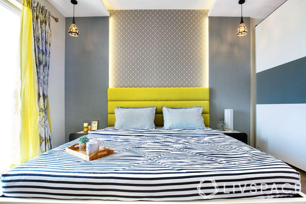 master bedroom design-backlit wall-yellow wall-hanging light