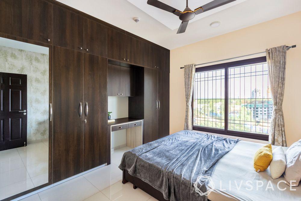 best interiors in bangalore-tile flooring-wooden laminate wardrobe-study unit
