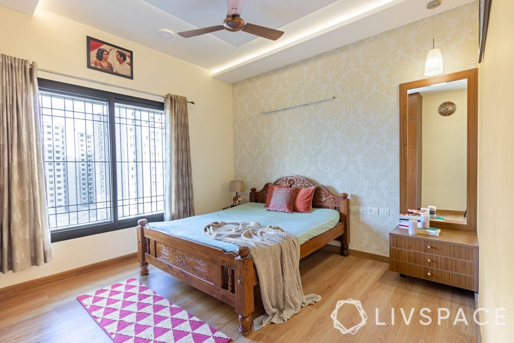 best interiors in bangalore-wooden flooring-wooden laminate wardrobe-vanity unit-carved wooden bed