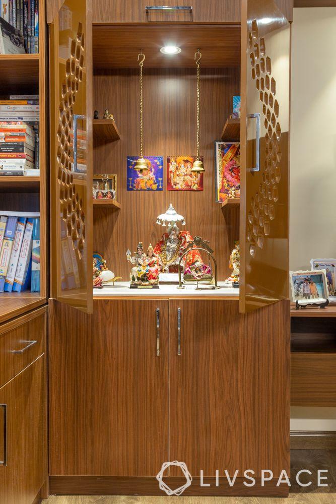 Pooja room designs in plywood-jaali doors-storage