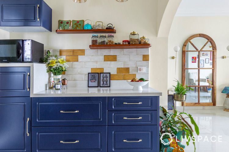 how to clean house-floating shelves-blue cabinets-white countertop