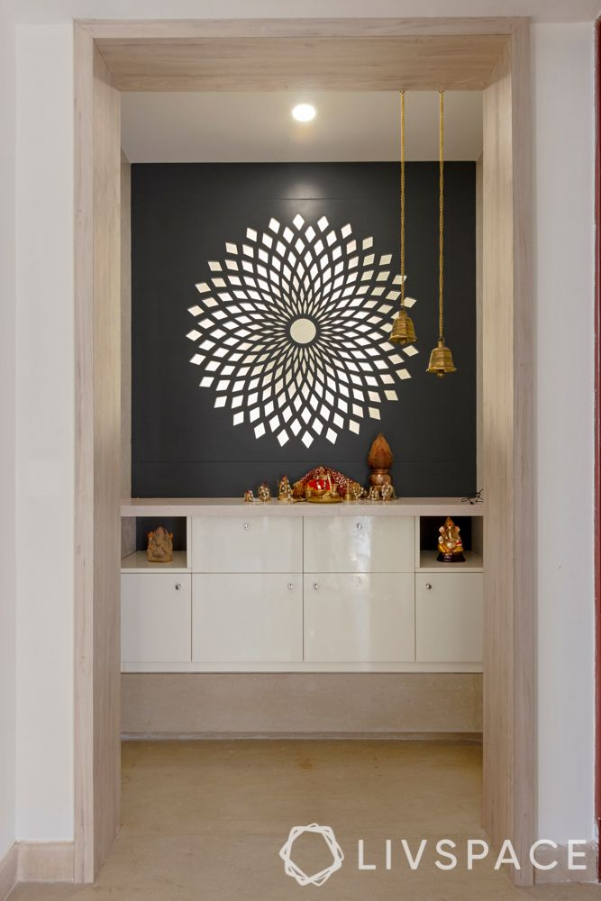 villa house design-MDF panel-backlit pooja room-hanging bells-storage-niche wall