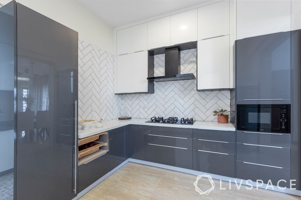 iles villa house design-open kitchen-anti-scratch-subway tiles-herringbone pattern-high gloss laminate