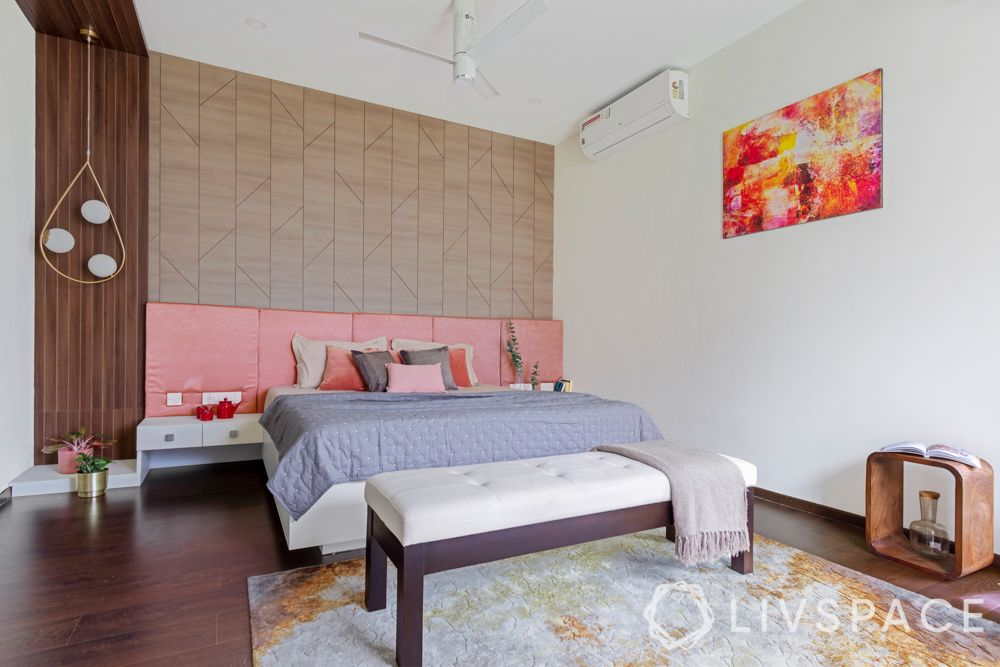 villa house design-wooden panelling-pendant lights-pink headboard-bench-orange armchair-study unit