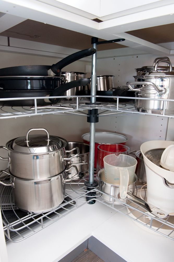 kitchen base cabinets-stacked utensils-kitchen appliances
