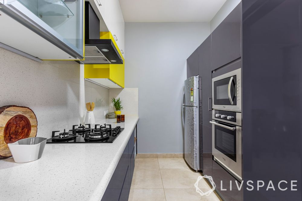 2bhk design-parallel kitchen-high gloss laminate finish-inbuilt appliances