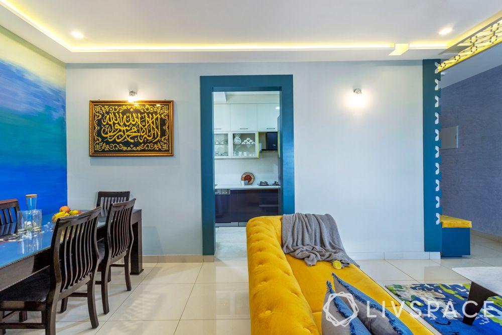 dining room-false ceiling design-suede sofa-jaali-kitchen entrance