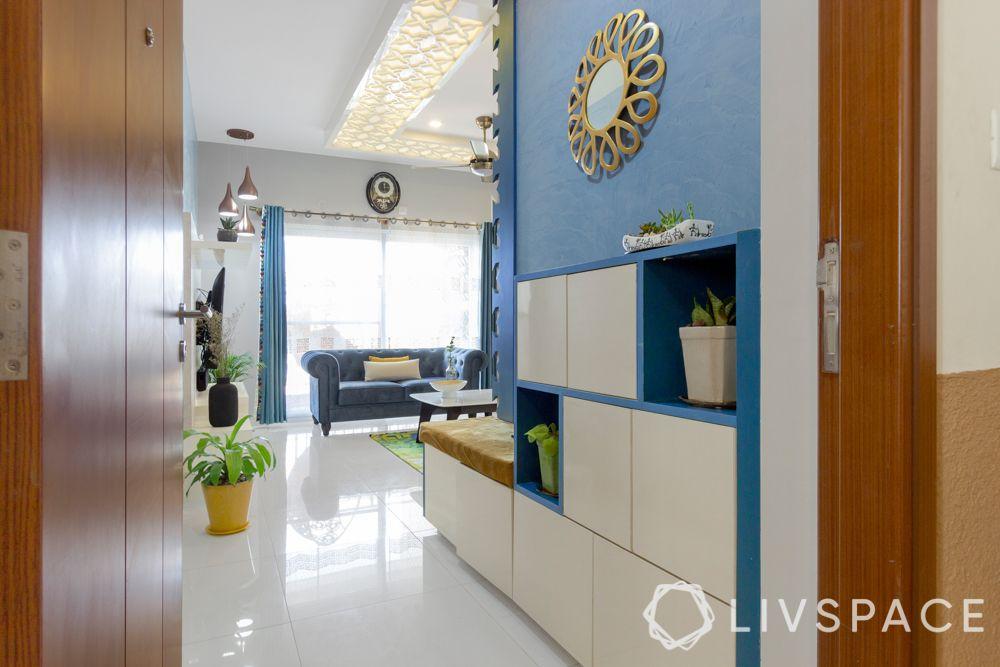 bengaluru home-foyer design-denim blue wall-textured paint-shoe rack
