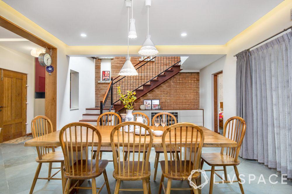 villa interior-wooden dining table-exposed brick wall
