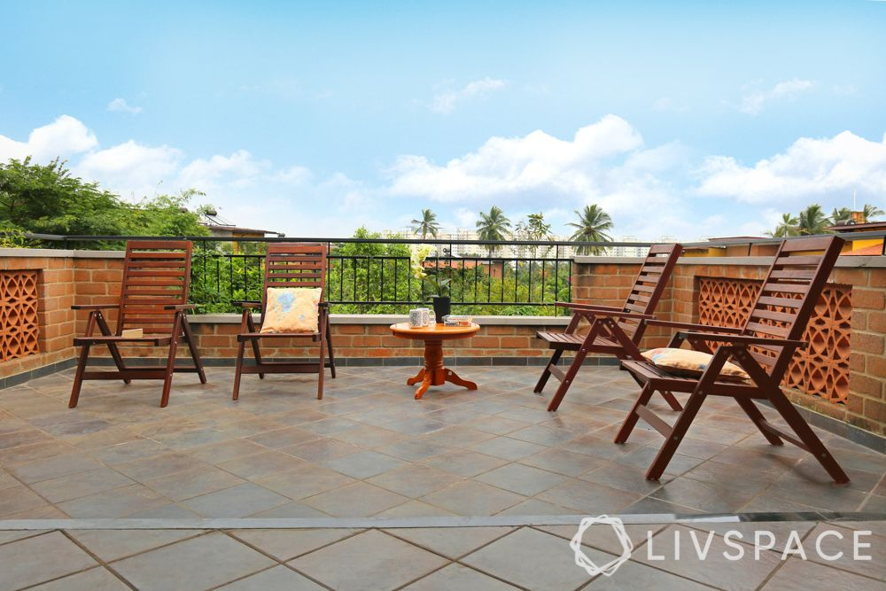 villa interior-wooden outdoor chairs-red oxide flooring