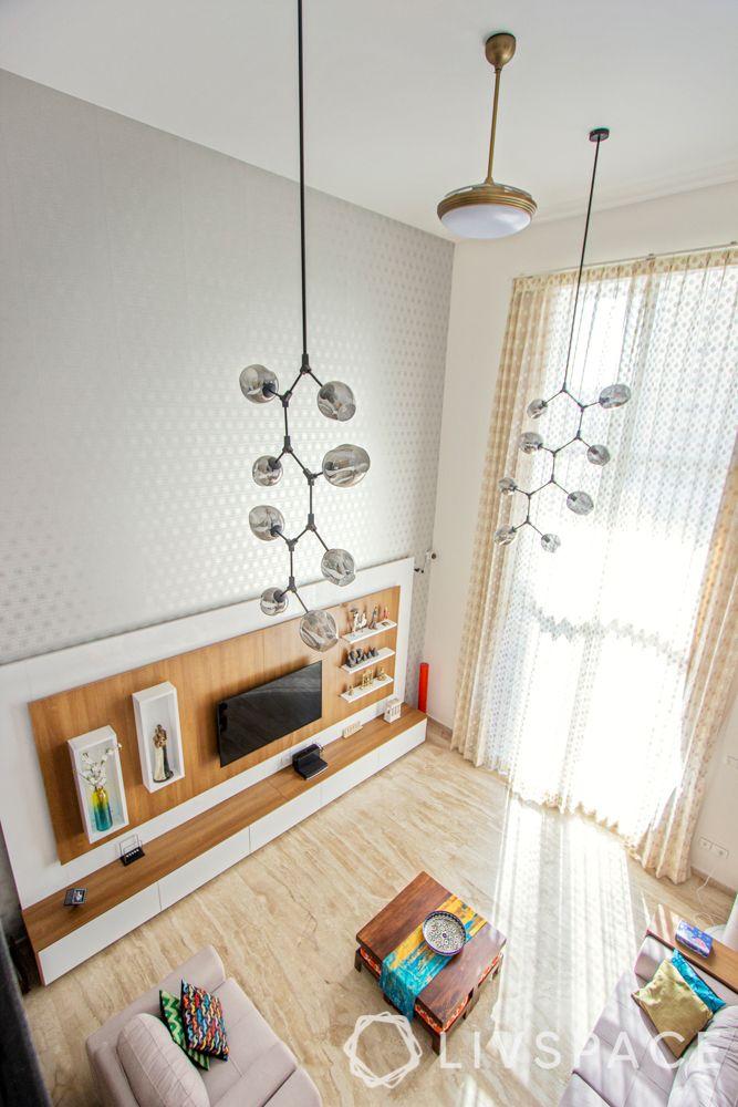 villa interior-wooden flooring-long cluster of lights