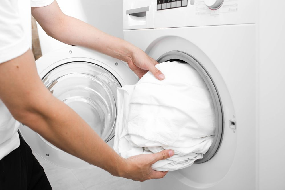 how to reduce allergies at home-washing machine-bedding