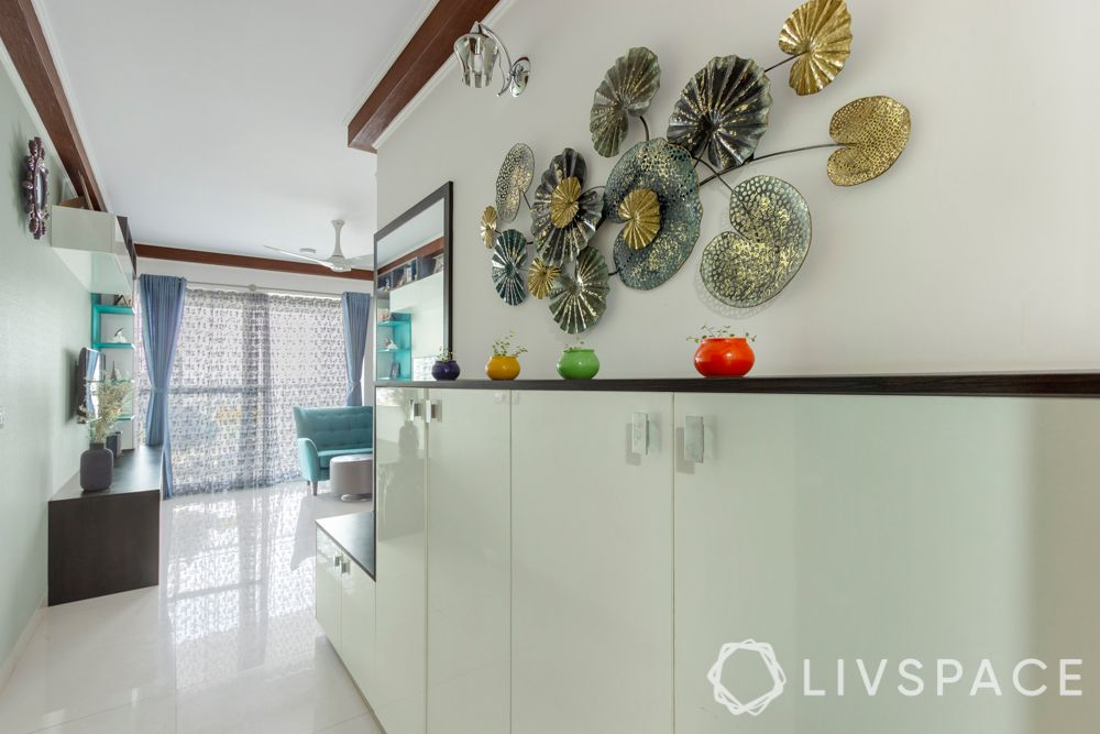 3 bhk interior-white shoe cabinet-entryway design