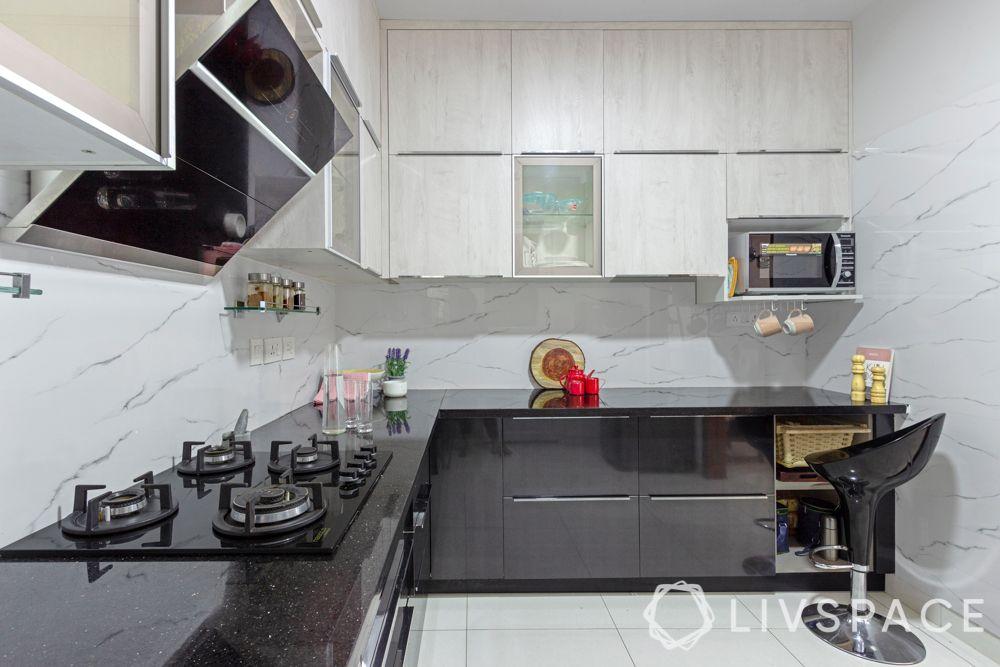 3 bhk interior-grey and white kitchen-black countertop
