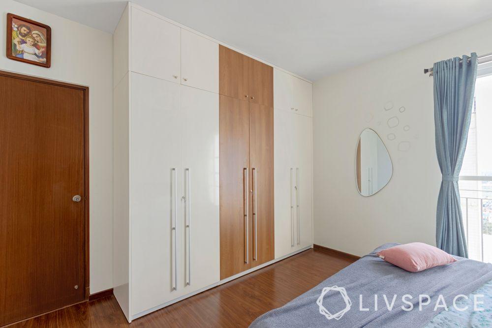 3 bhk flat interior images-white and brown wardrobe-membrane wardrobe
