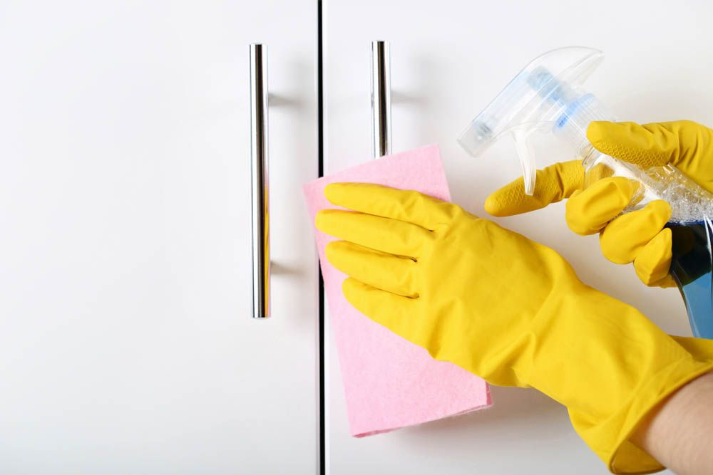 high-touch-surfaces-during-coronavirus-cabinet-handles-cleaning