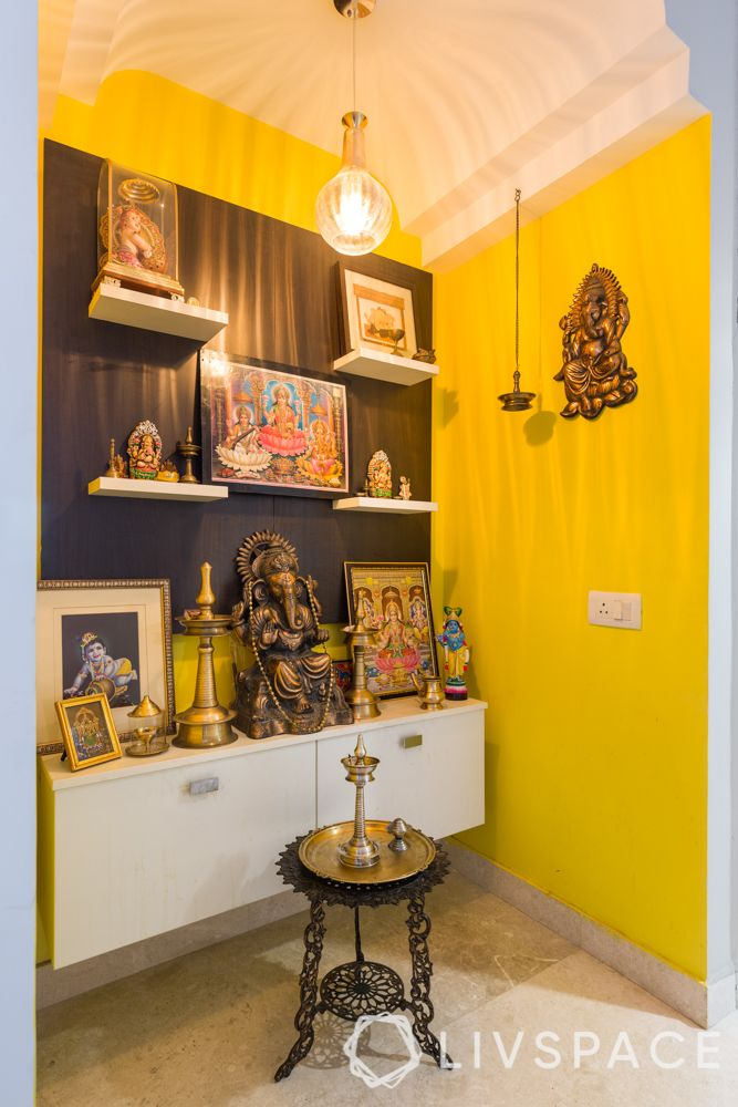 new mandir design-yellow walls-lighting-bells-idols