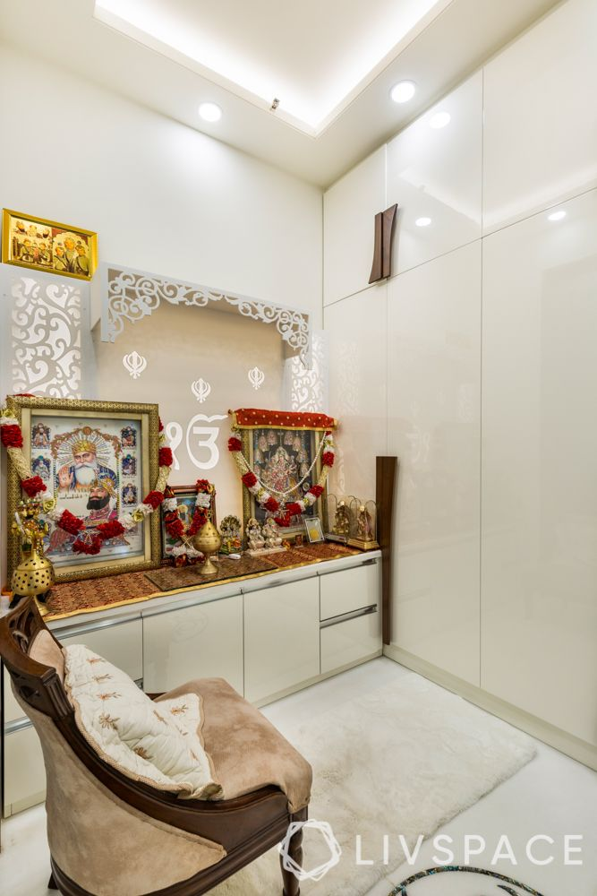 new mandir design-white cabinets-chair-pooja room