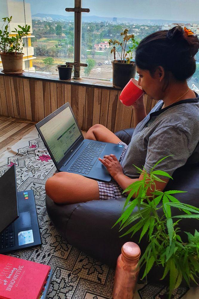 home office design-balcony workspace-plants-water bottle