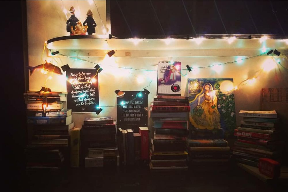 home office design-study unit-fairy lights-books-posters