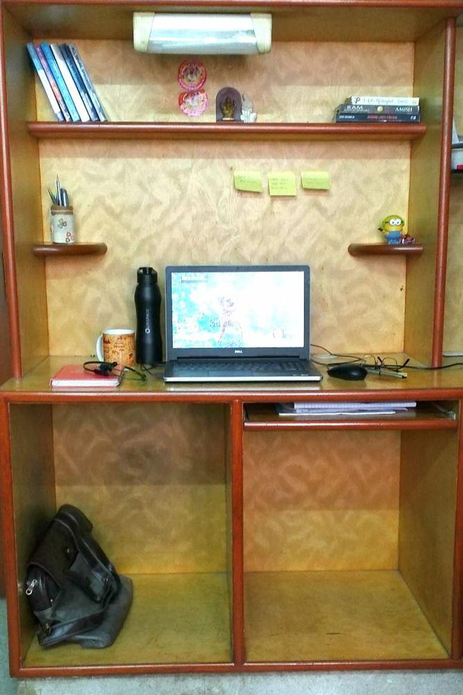 home office design-study unit-books-laptop-bottle