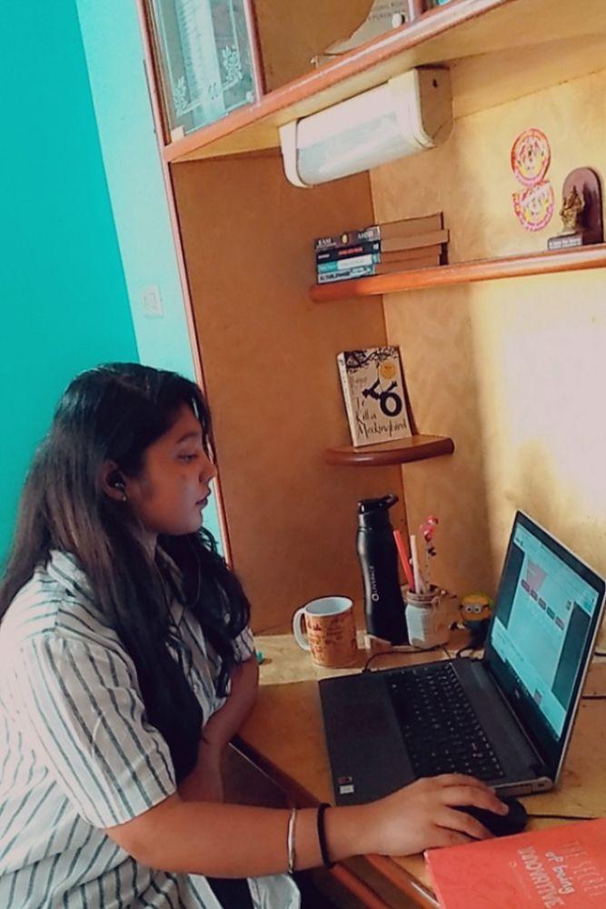 study unit-books-laptop-bottle